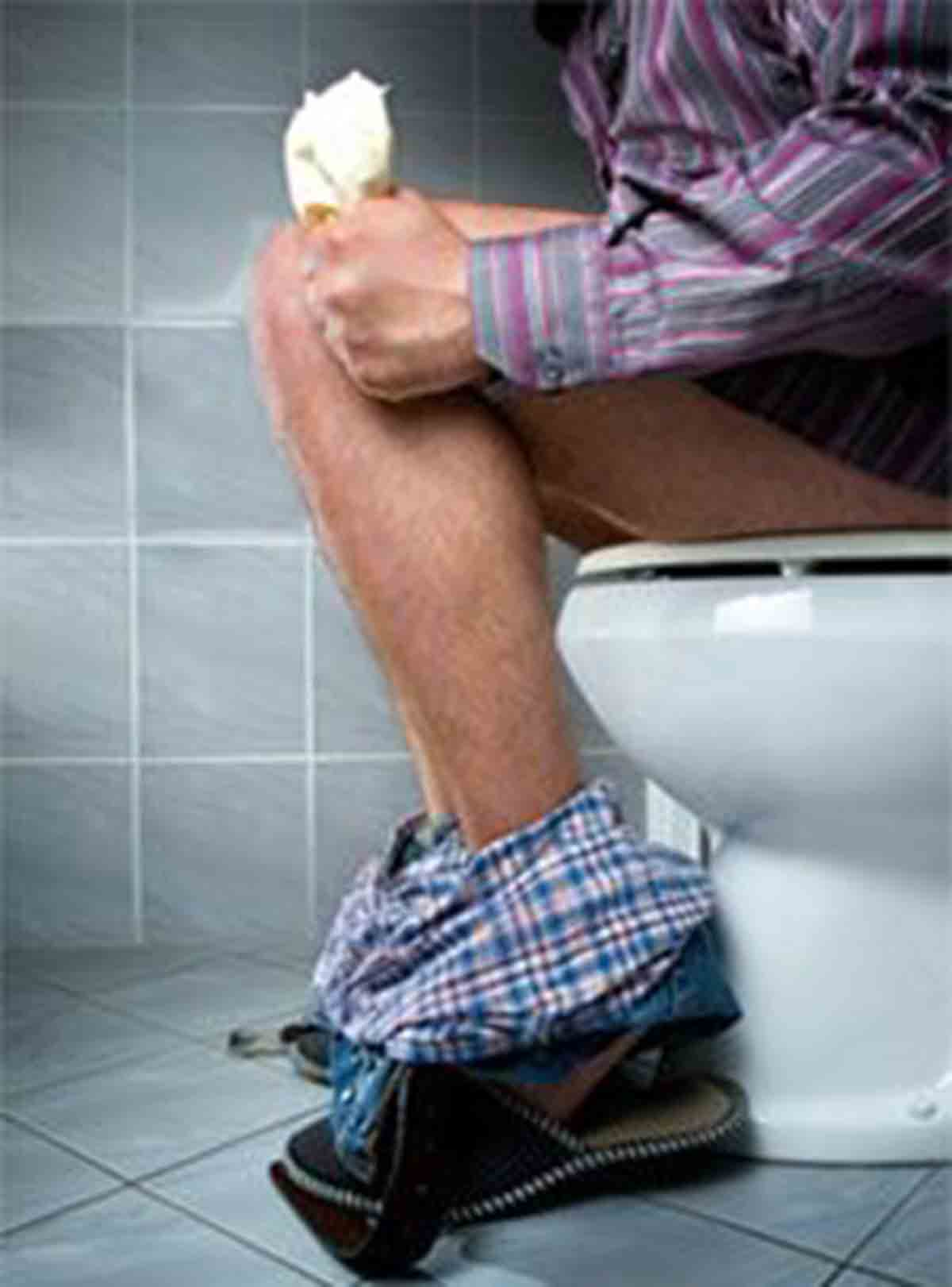 Guy sitting on the toilet