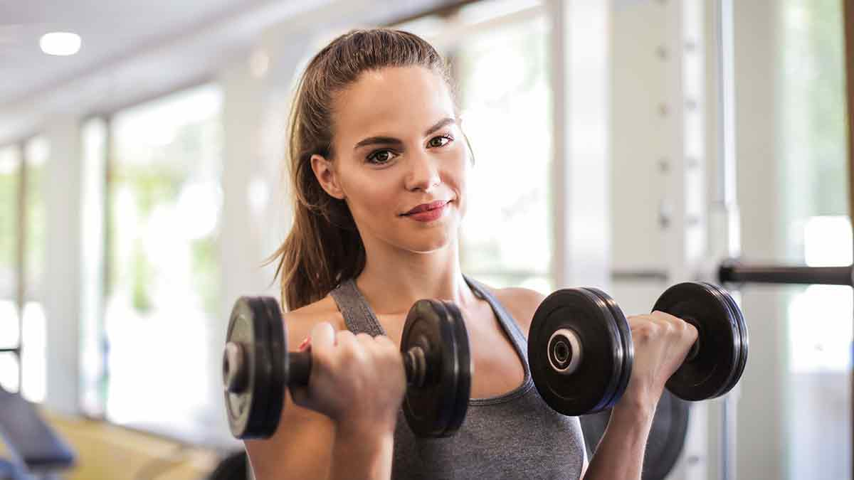 Active woman bicep curls
