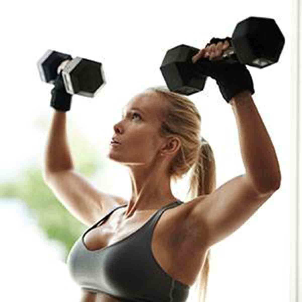 10 Common Weight Loss Mistakes, woman lifting weights