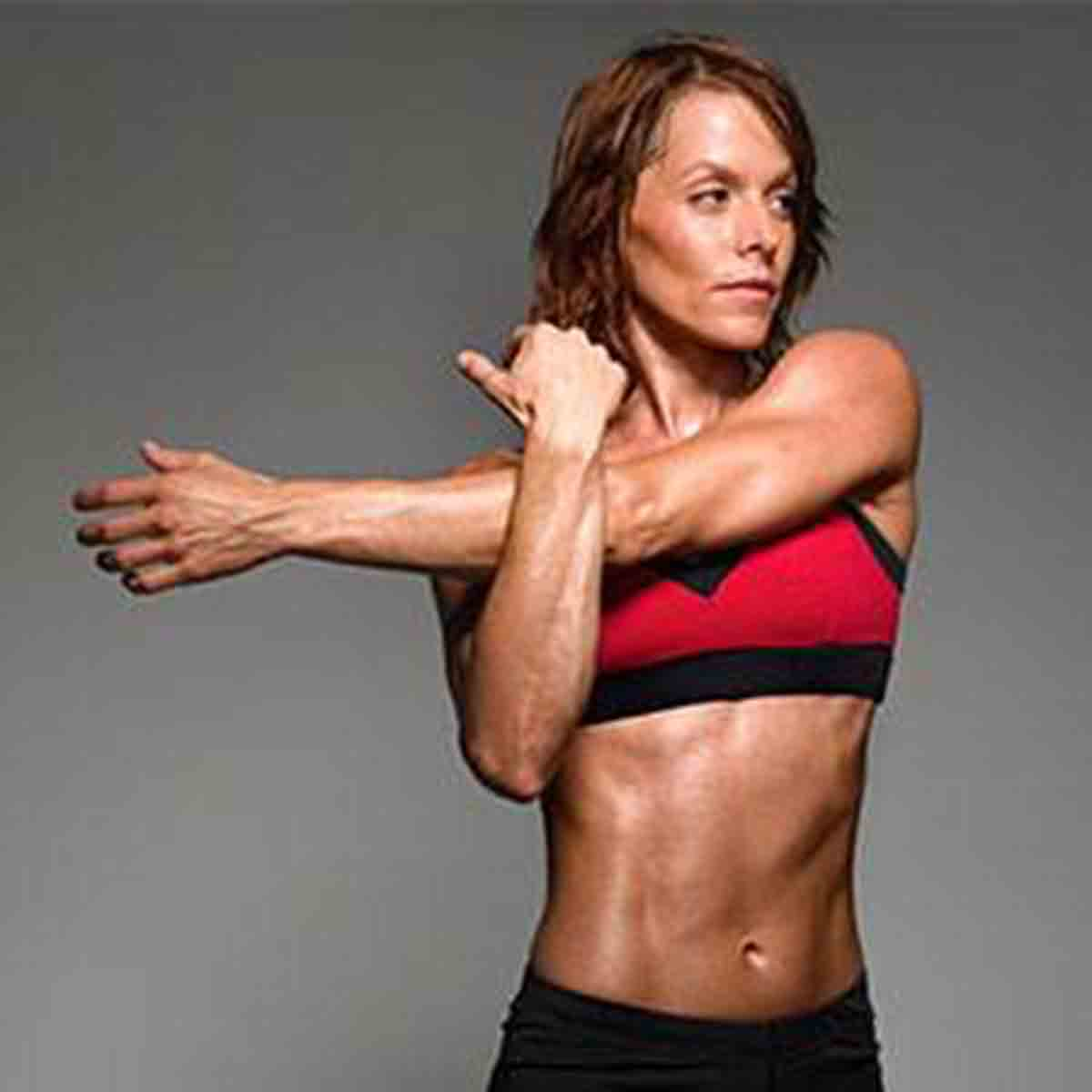 Muscle Mass and Body Composition, woman stretching inducing metabolism