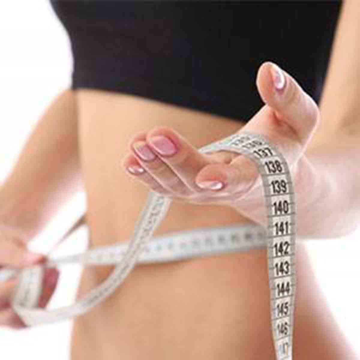 Ingredients In Supplement Make No Difference To Weight Loss - Woman Measuring Tape